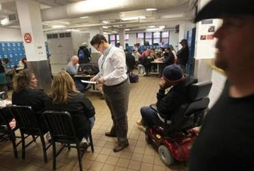 Elizabeth Condron, an employee at the shelter, helped residents fill in the voter registration forms. Seventy-one residents registered to vote during the event.